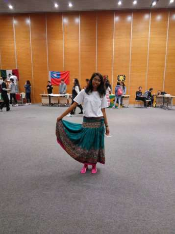 Me showing off my skirt and my pink socks