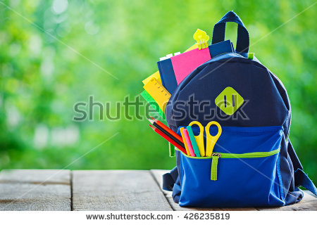 stock-photo-full-school-backpack-on-wooden-and-nature-background-426235819